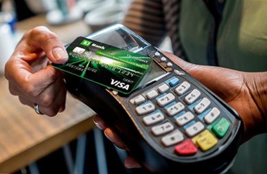 Image of a TD GO card being tapped to complete a transaction
